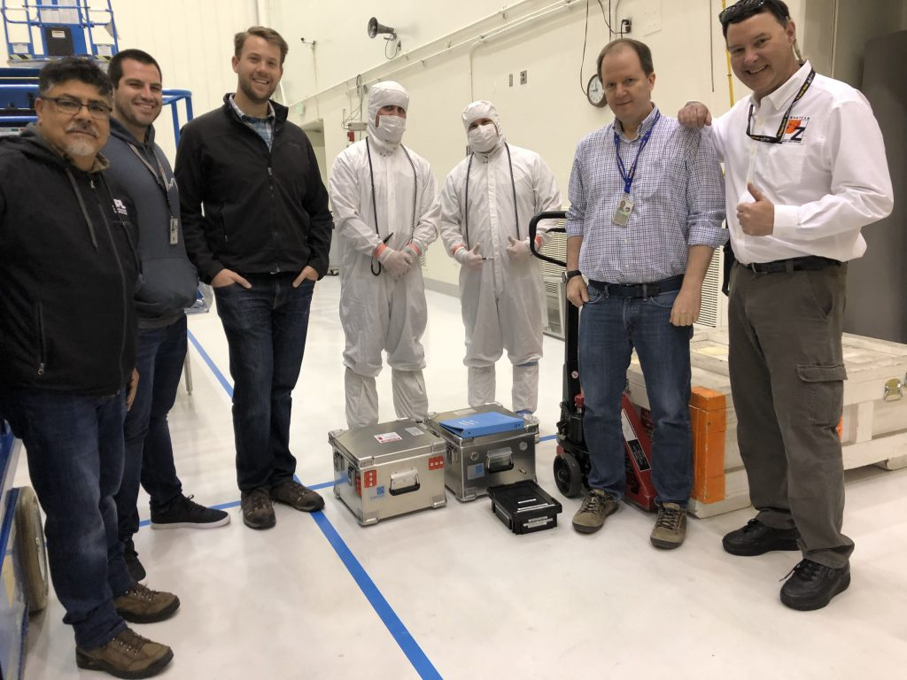 """Members of the Mastcam-Z and JPL Mars 2020 Assembly, Test, and Launch Operations (ATLO) team gathered for a milestone moment in JPL's Spacecraft Assembly Building on May 21, 2019: formal """"delivery"""" of the cameras (packed inside the special flight hardware carrying boxes) to the rover!"""