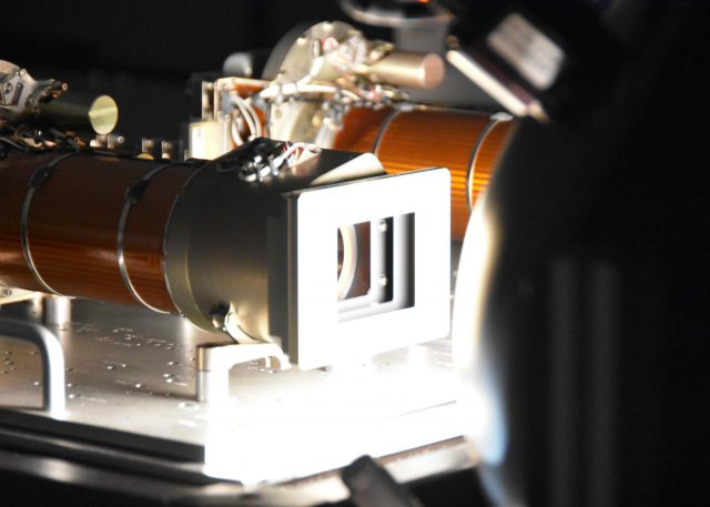 """Close-up view of one of the Mastcam-Z flight cameras looking into a bright """"integrating sphere"""" light source in the clean room at Malin Space Science Systems as part of the camera calibration activities in May, 2019."""