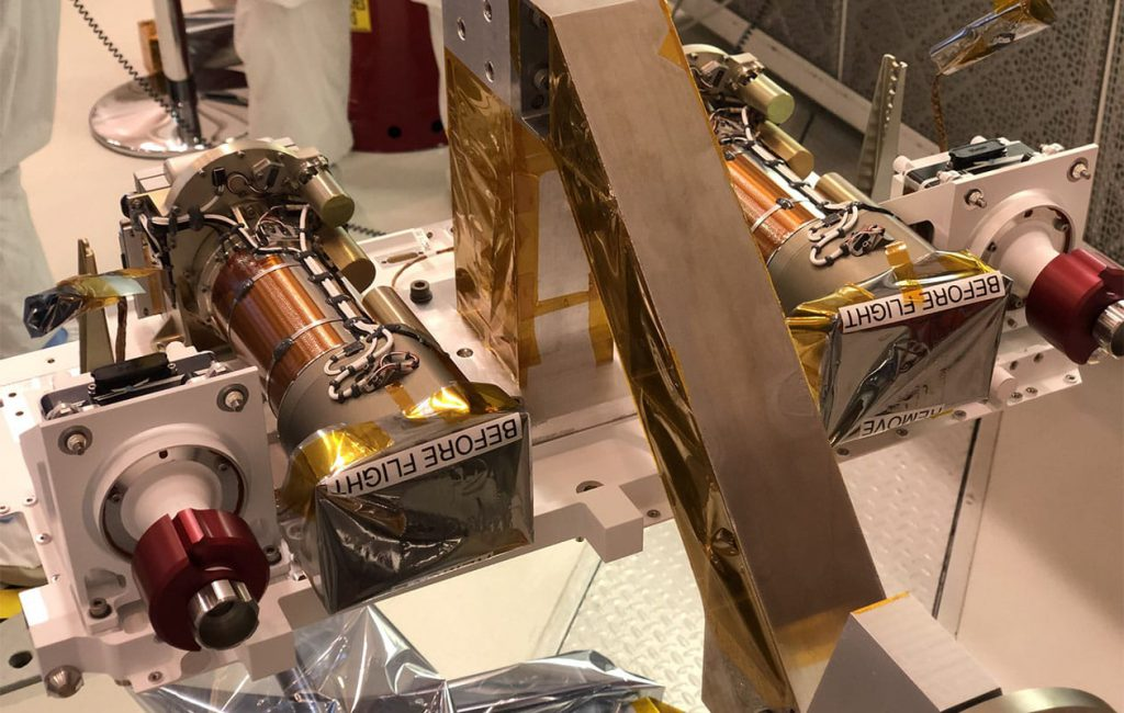 Left and right Mastcam-Z camera heads after integration into the Perseverance rover's remote sensing mast (RSM) at JPL, June 2019.